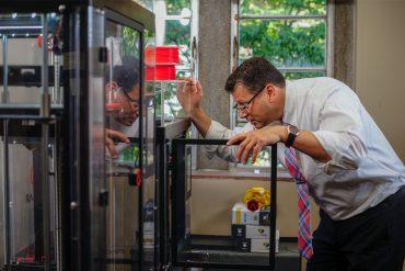 Matthew Mench checks on TEL BOXX in 3d Printer