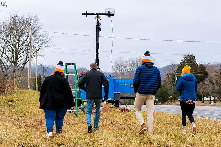 Students Walking Toward Signal Trailer